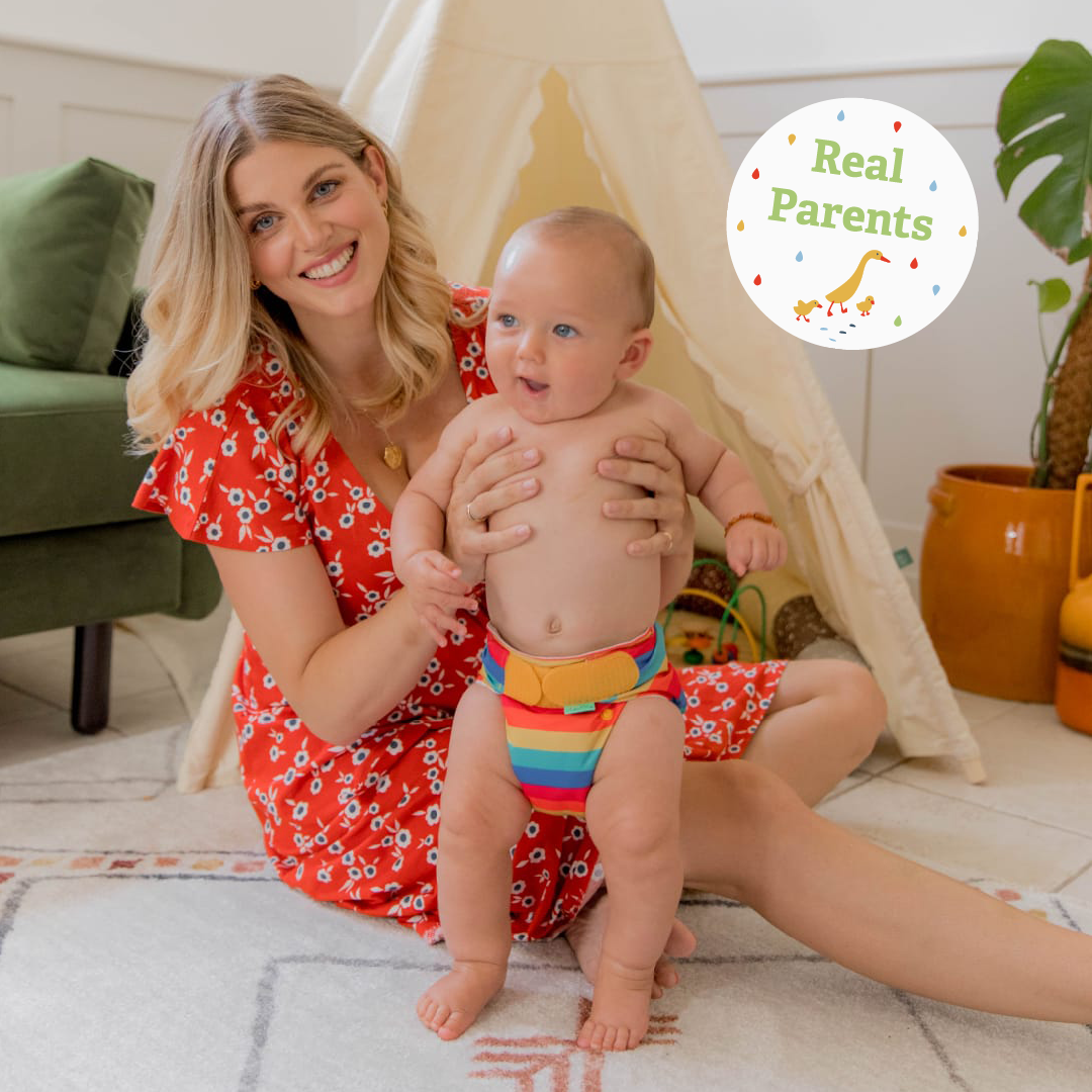 Real Parent Ashley Louise James holding her baby, Alfie, wearing a reusable nappy